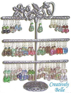 With 60 holes the three tier earring stands can carry a pair of earrings per hole. Earrings can also hang over the decoration.