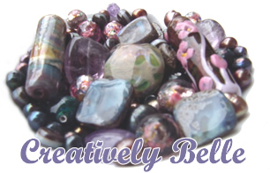 Creative fun - a dish of opals, pearls, handmade glass and gemstones
