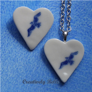 Collection of blue and white heart albatross necklace and brooch
