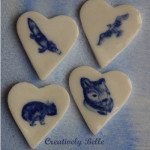 Family of Australian animals in heart brooches