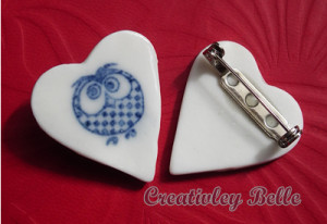 Blue and white porcelain owl pin front and back view