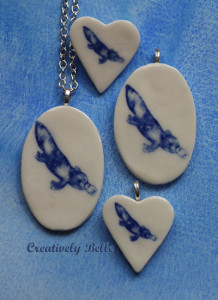 A family of platypuses in brooches and necklaces