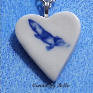 Heart shaped platypus blue and white necklace