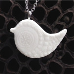 Porcelain jewellery with the organic shapes of the lotus seed pod