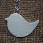 Creatively Belle peace bird long necklace