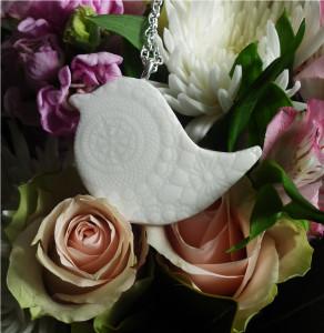 Original artisan porcelain peace bird pendant on a long necklace chain