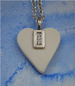 The back detail of the porcelain necklaces