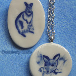 Kangaroo and joey necklaces and pins by Creatively Belle