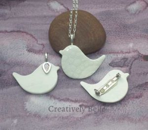 Peace Bird front and back necklace and brooch collection ceramic jewellery by Creatively Belle