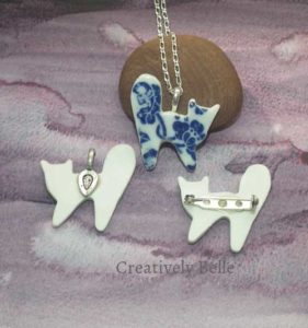 Meow Meow, here's the studio Cat front and back necklace and brooch collection ceramic jewellery by Creatively Belle at The Rocks Markets