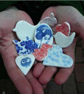 A handful of porcelain brooches made by Creatively Belle