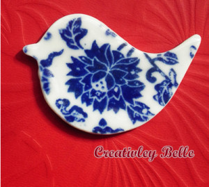 Detail of the blue and white porcelain bird brooch