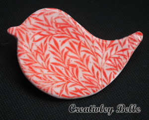 Bright coral red porcelain bird pin