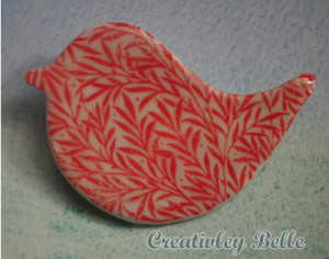 Vibrant coral red porcelain bird pin