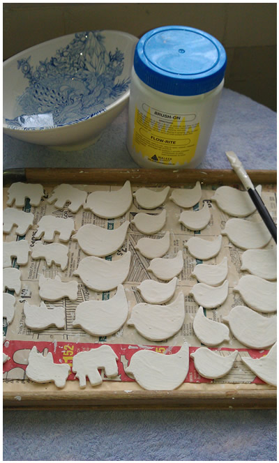 With glaze painted on, these are ready for the glaze firing