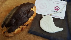 Chocolate eclair and Creatively Belle Peace Bird jewellery at The Rocks Markets